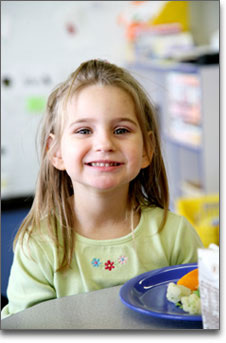 Childcare Meals - Happy Girl Eating Lunch
