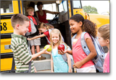 Childcare - Before School Care - children preparing to board a school bus