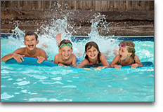 Childcare - Summer Camp - children swimming and having fun