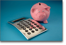 Childcare - Financial Services - subsidized childcare - photo of piggybank with calculator